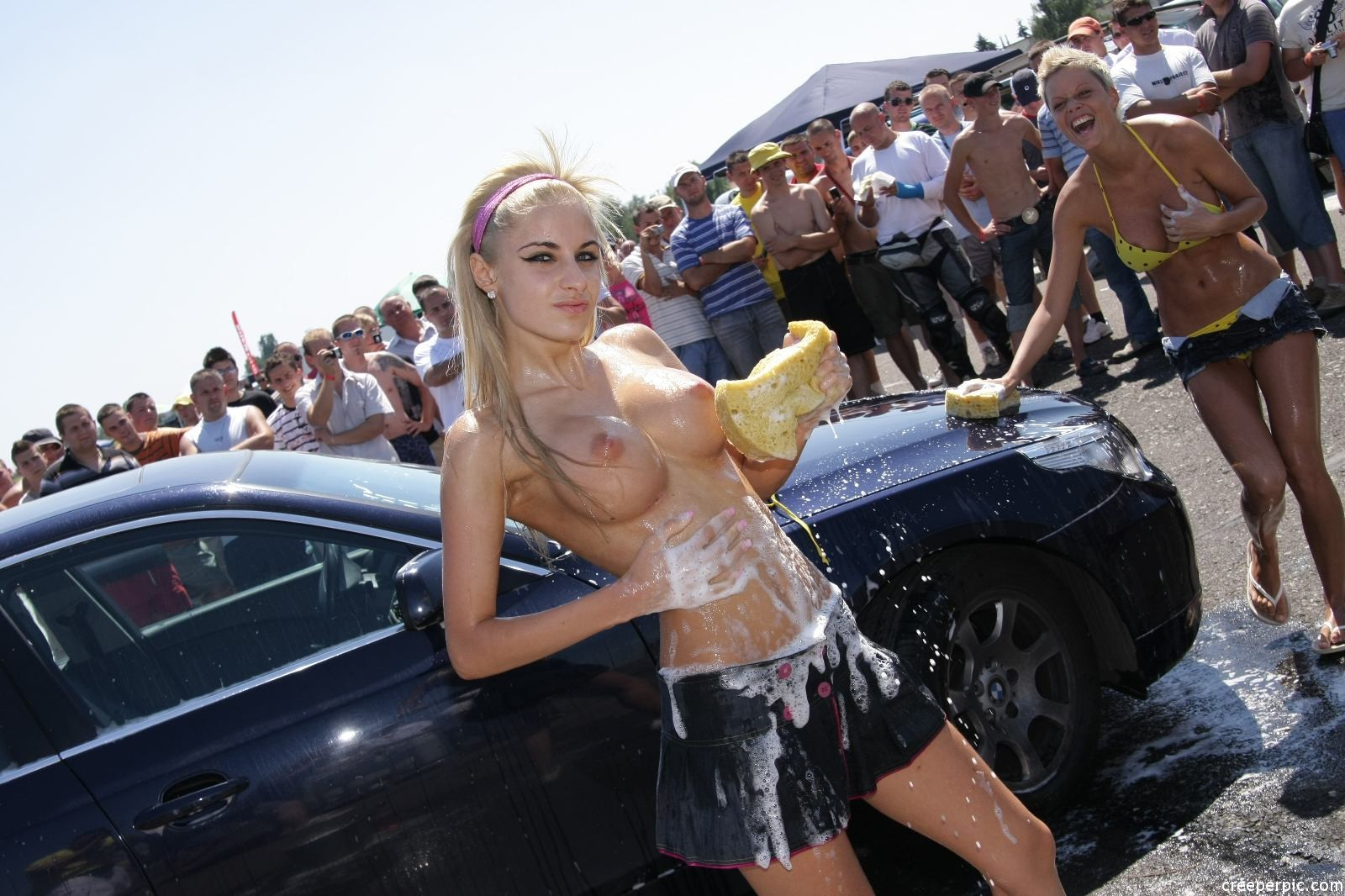 Kittens car wash pays women to clean cars wearing only bikinis and